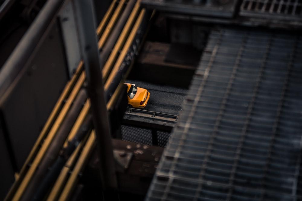 low-angle photography of orange car