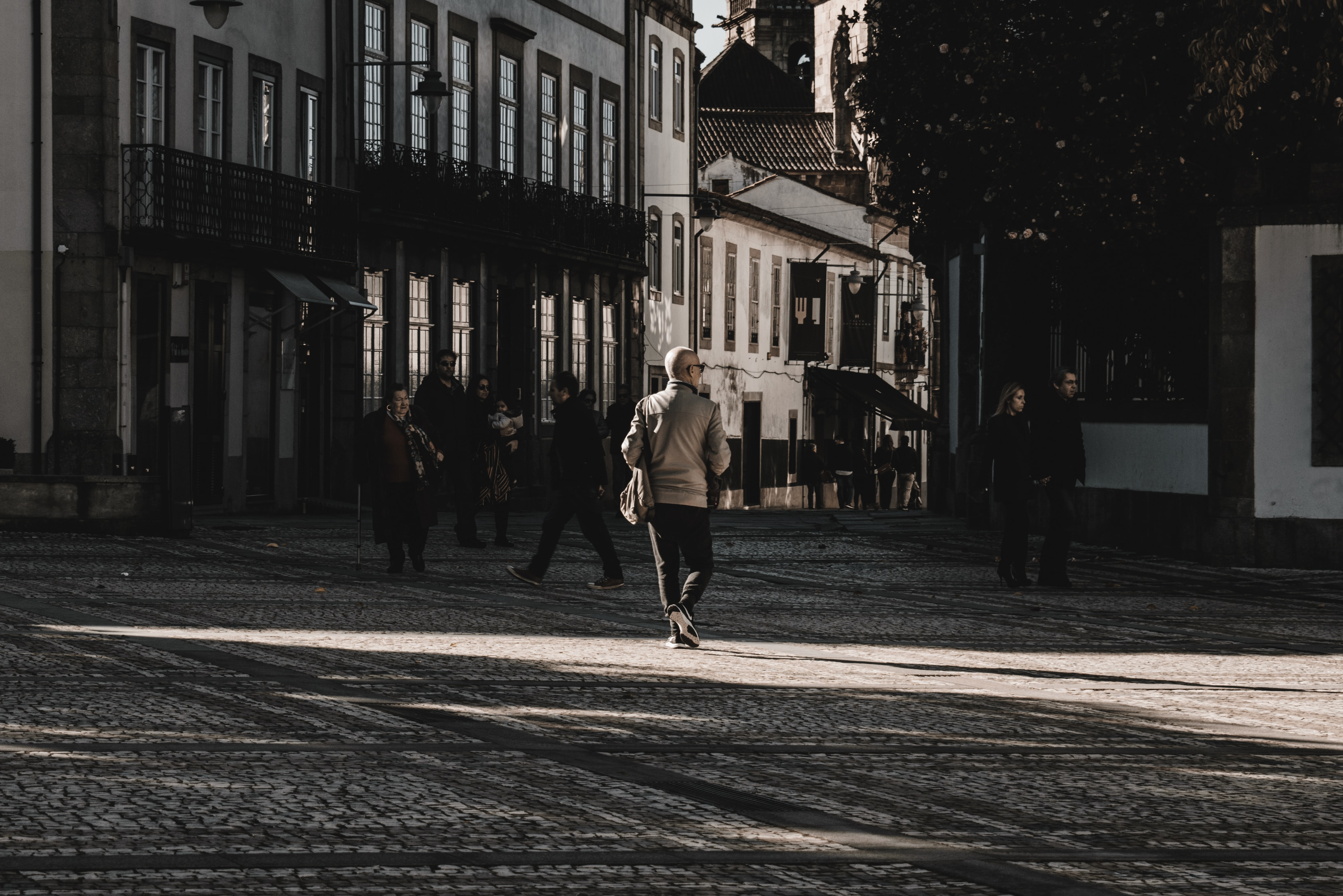 person walking on road