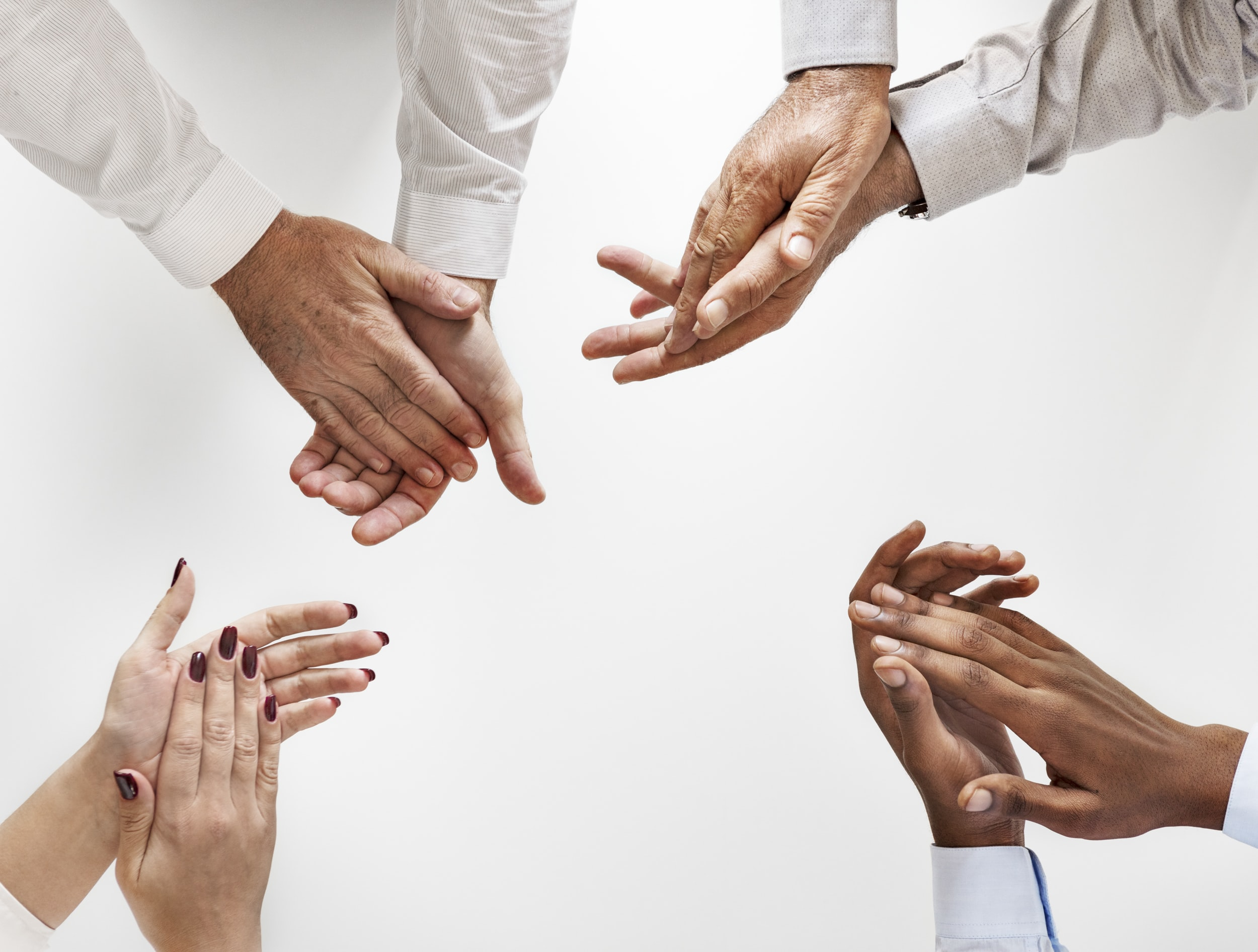 close-up photo of four person's hands