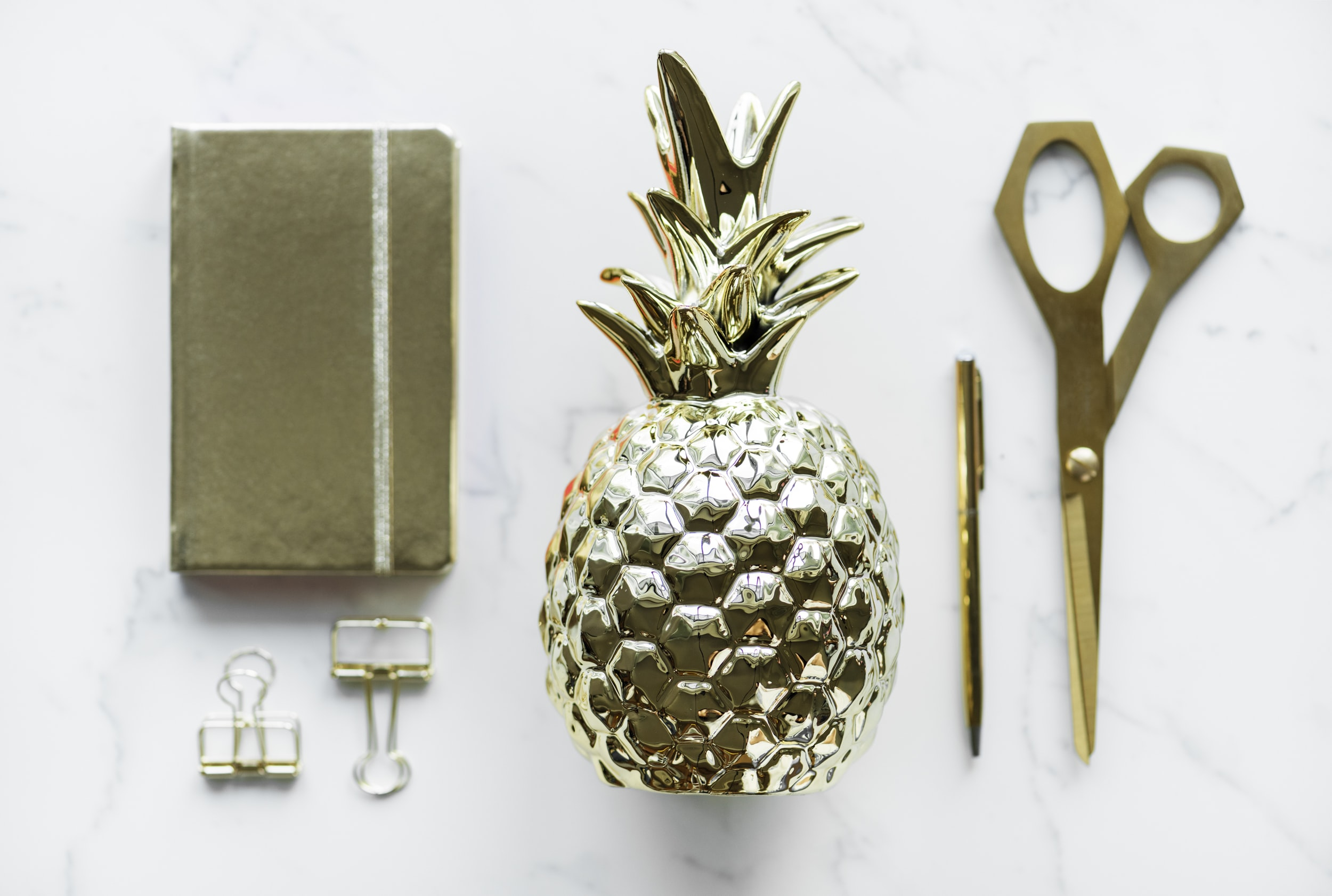 flat lay photography of scissors and book against white surface