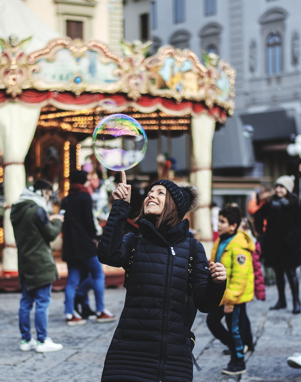 woman touching bubble on mid air