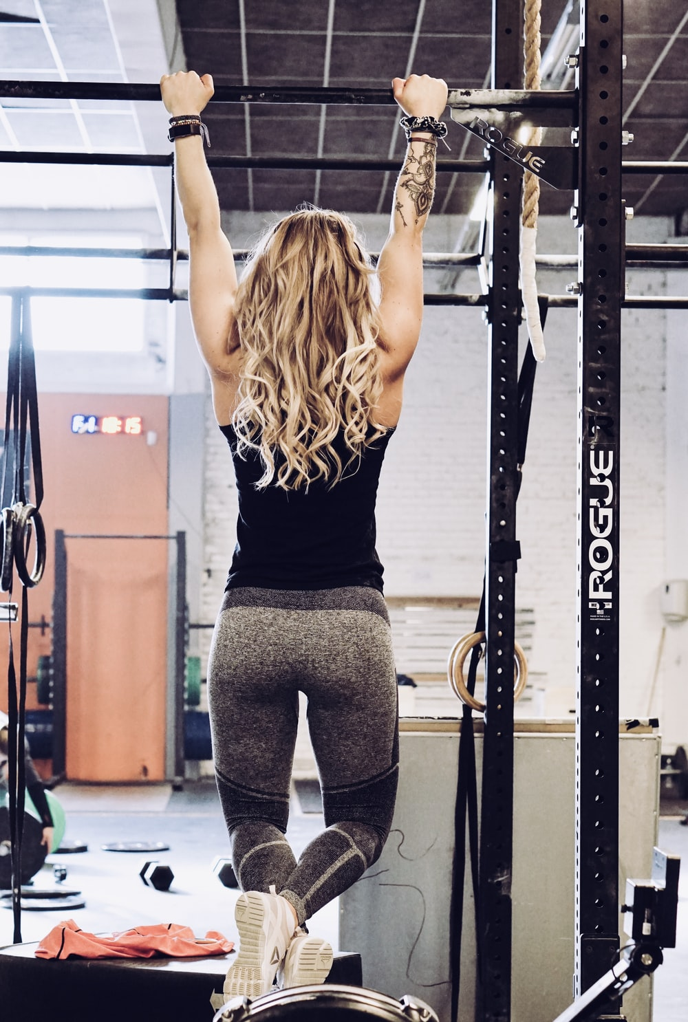 woman hanging on exercise equipment