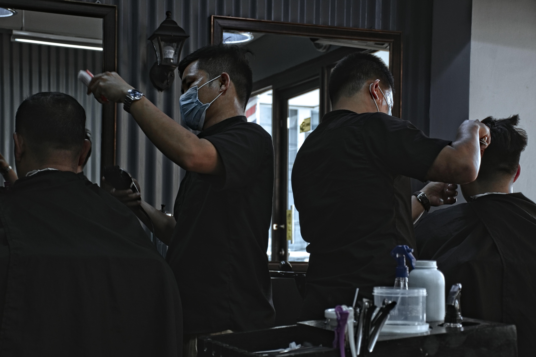 man hair cutting hair of man