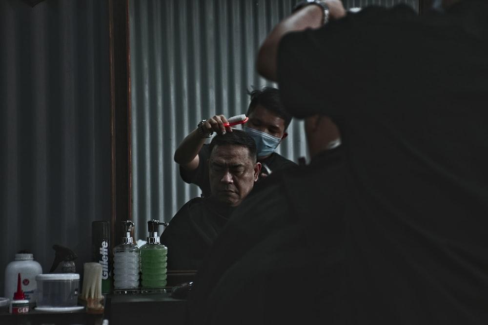 photo of man having a haircut