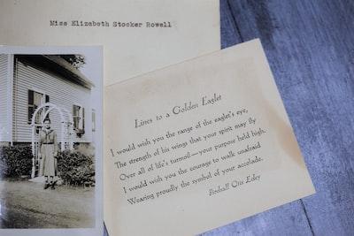 greeting cards on brown surface poem teams background