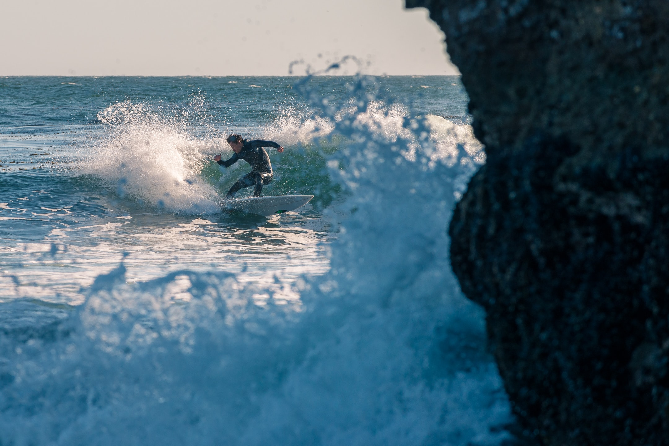 photography of surfboarding man