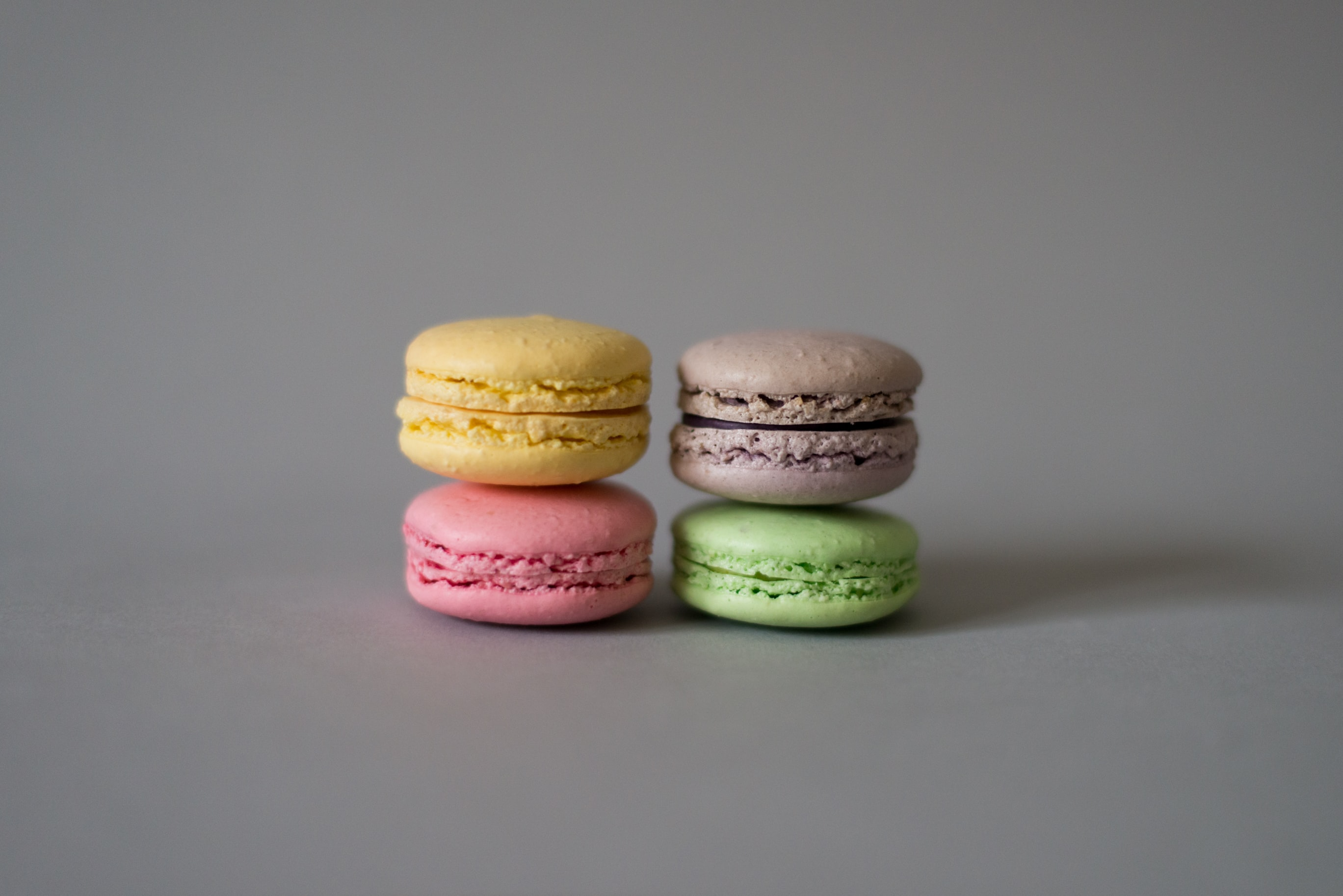 yellow, pink, brown, and green macaroons