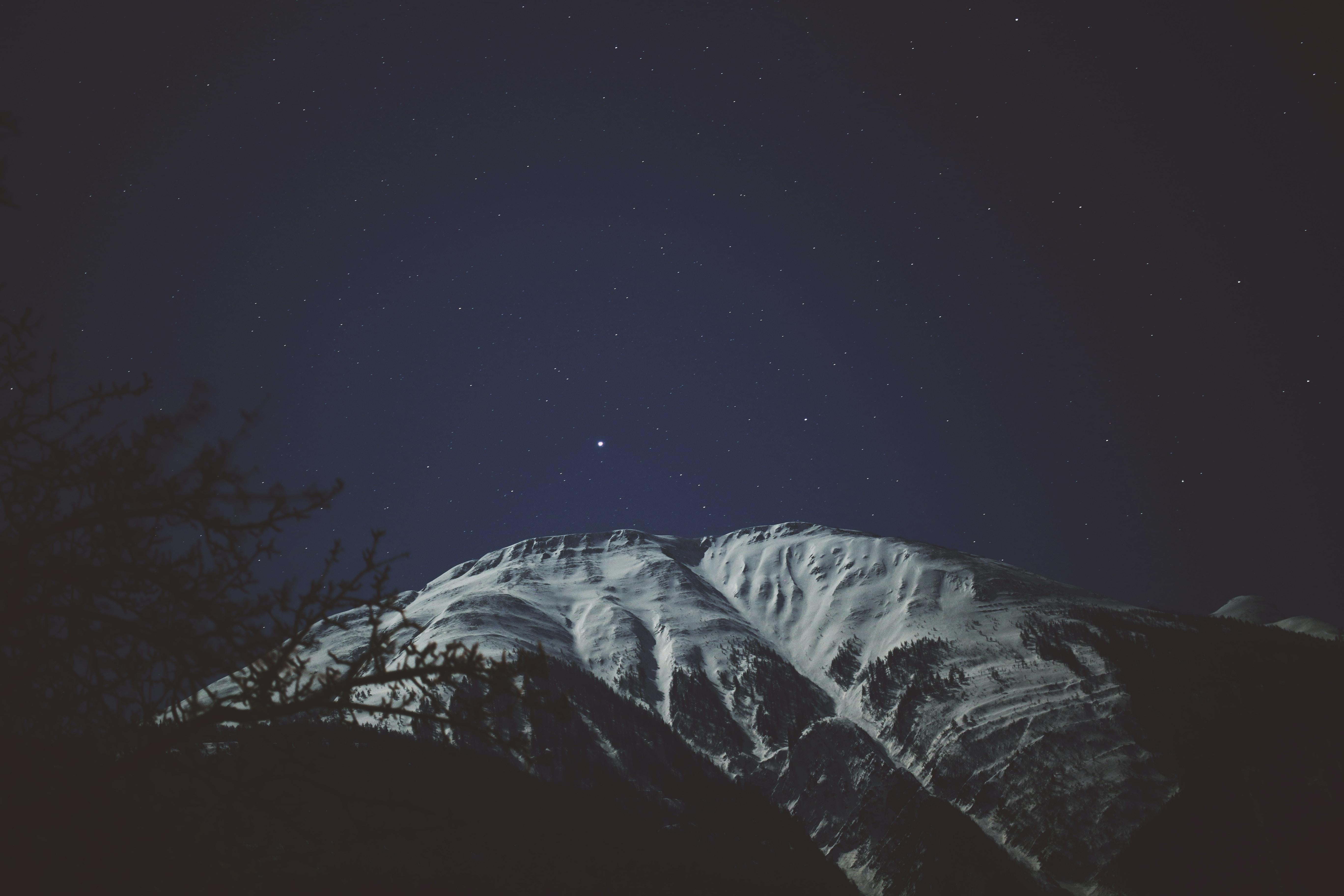 mountain peak during night time