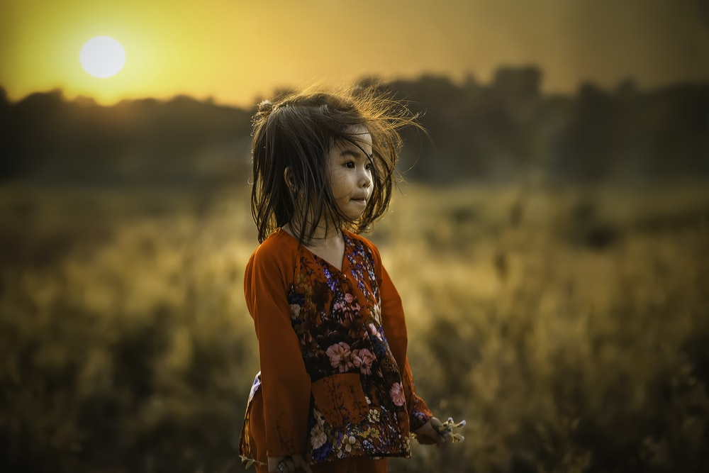 girl standing near field