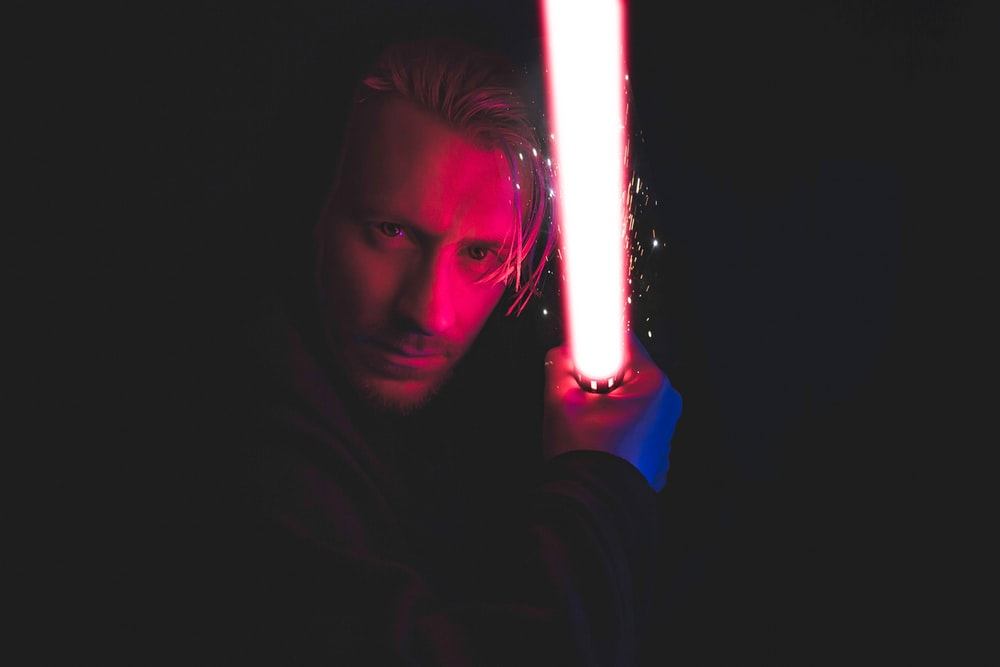 person holding red lightsaber