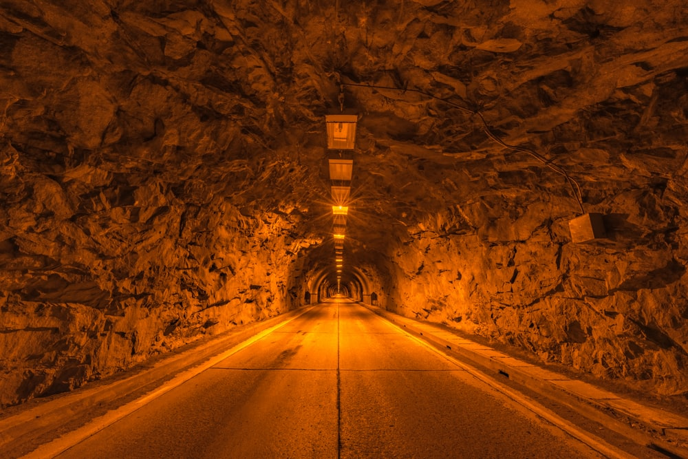 tunnel road with orange light fixture