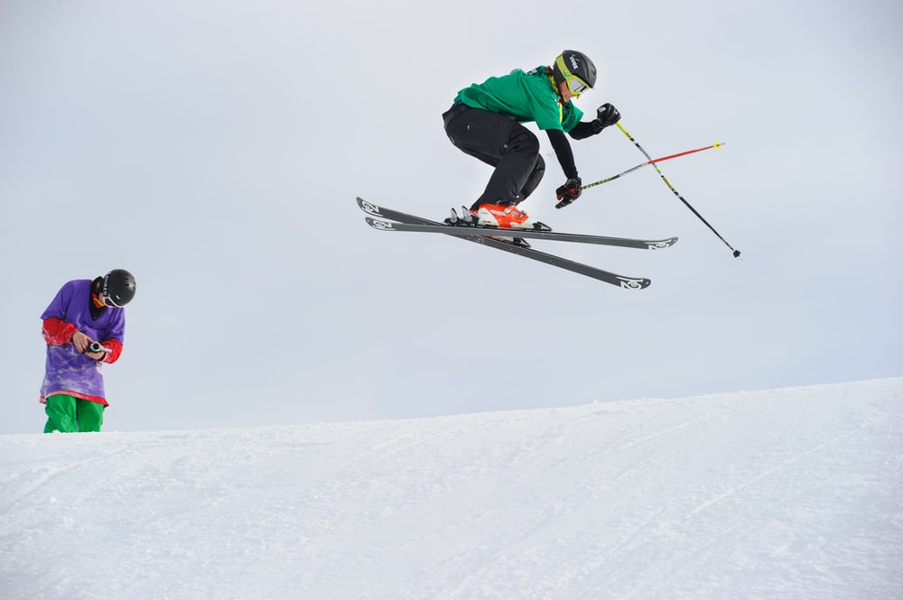 man riding snow skis