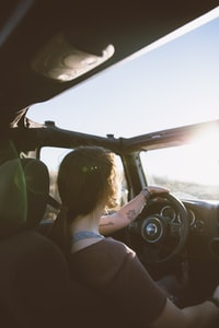 woman holding steering wheel while driving