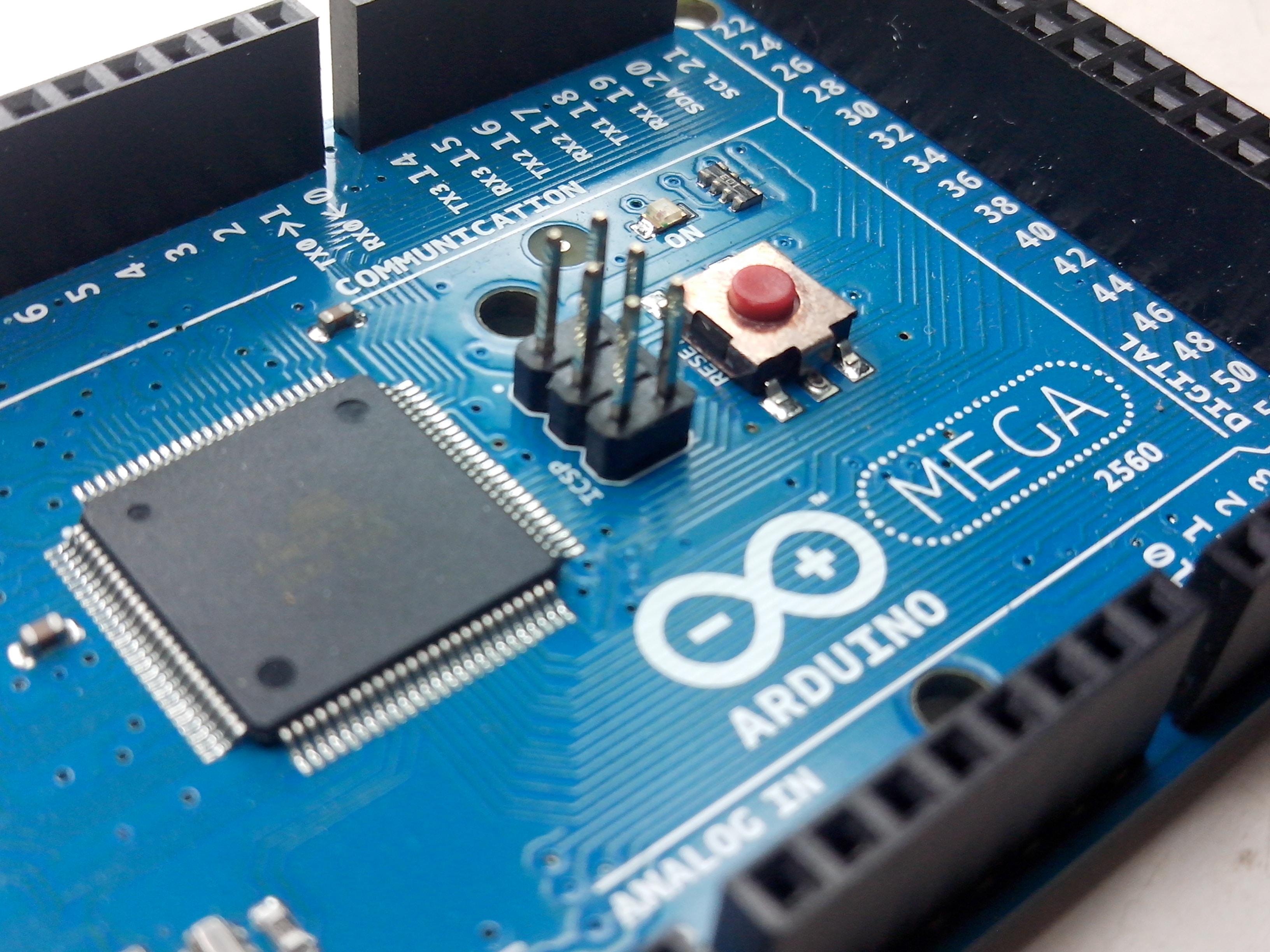 blue and black Arduino Mega circuit board