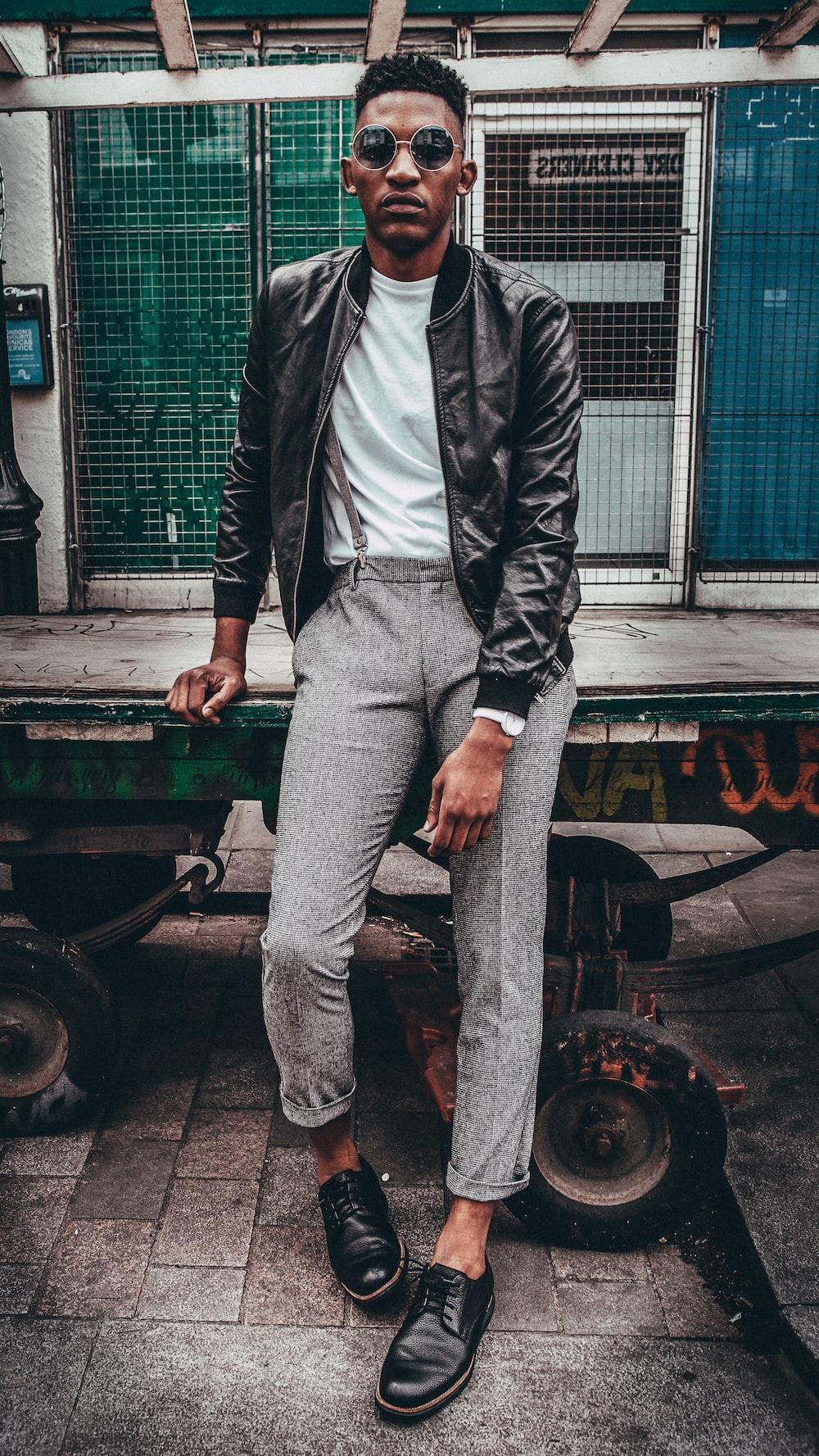 man in black jacket posing