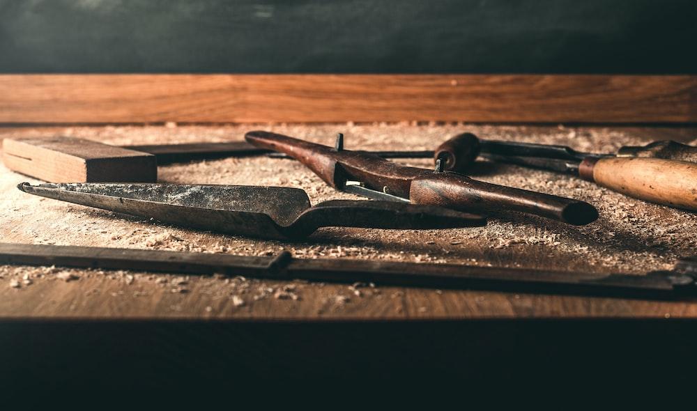 black hammer on brown wood
