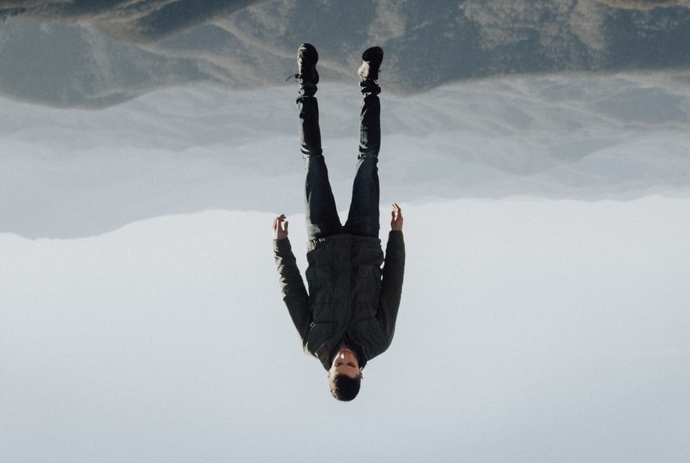 man floating above mountain