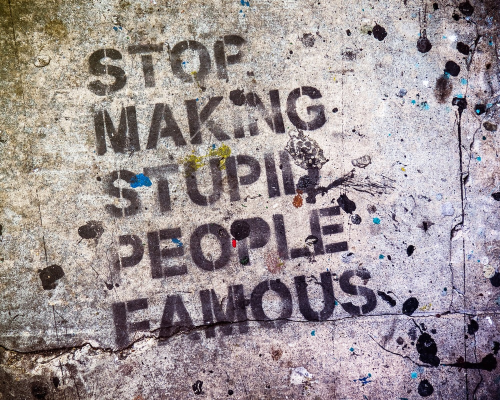 stop making stupid people famous text