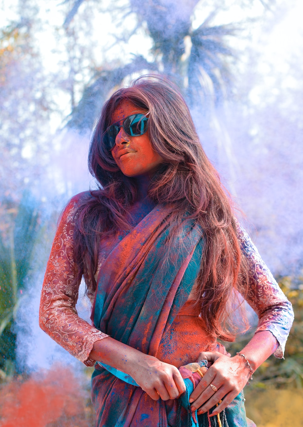 selective focus photo of woman wearing green and brown shawl covered with powder