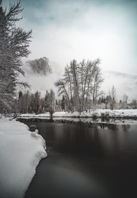 photo of river near snow field
