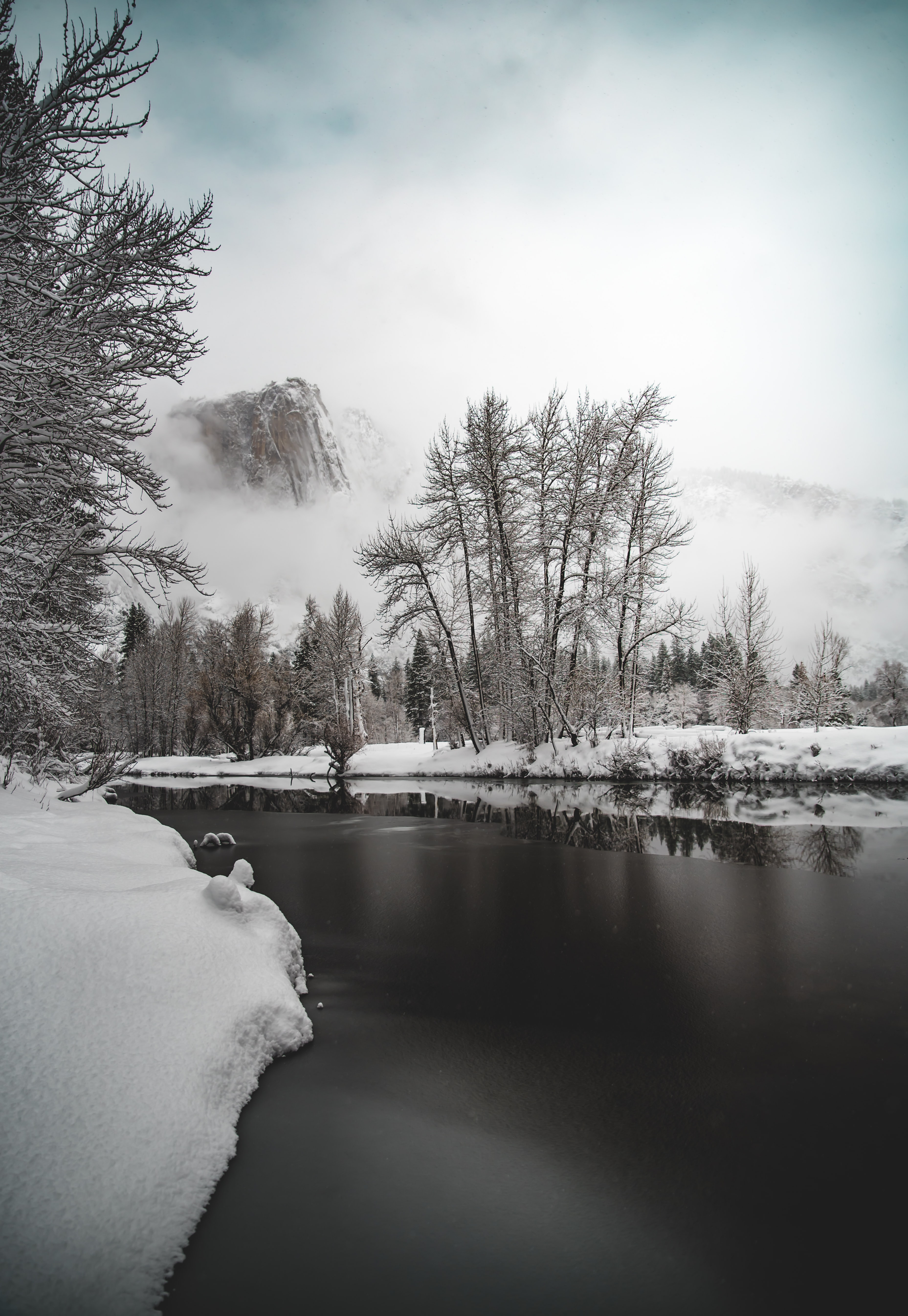 photo of river near snow field