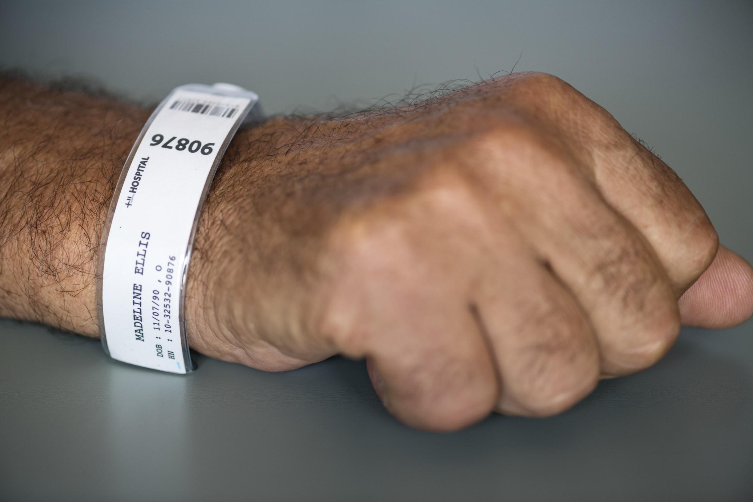 person wearing white bracelet