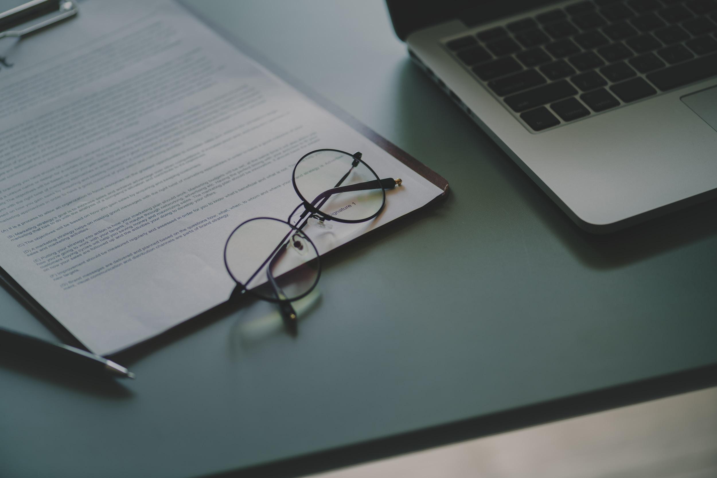 eyeglasses on white document paper