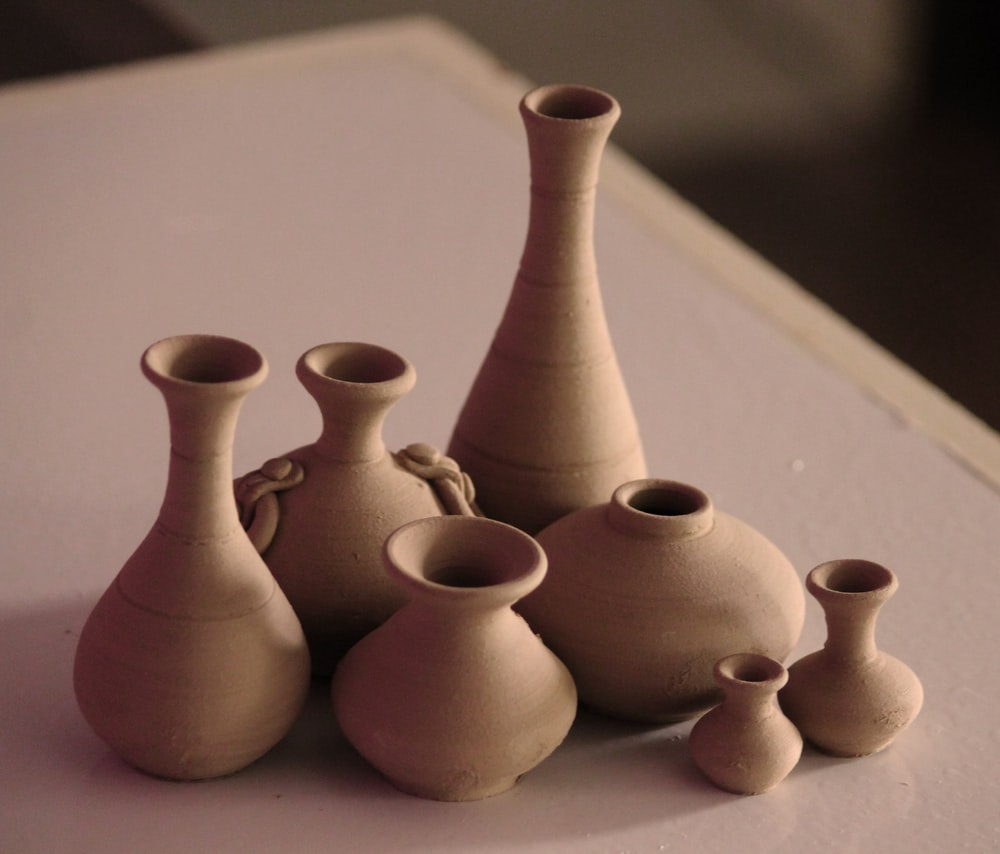 white clay vases on table