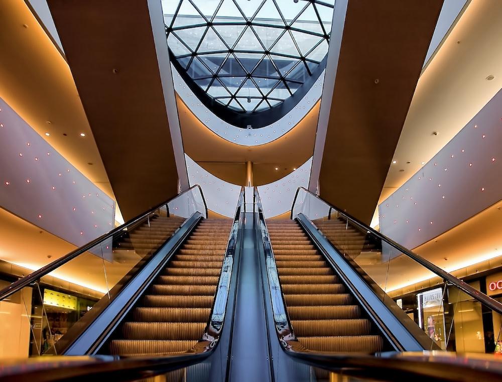 two grey escalator