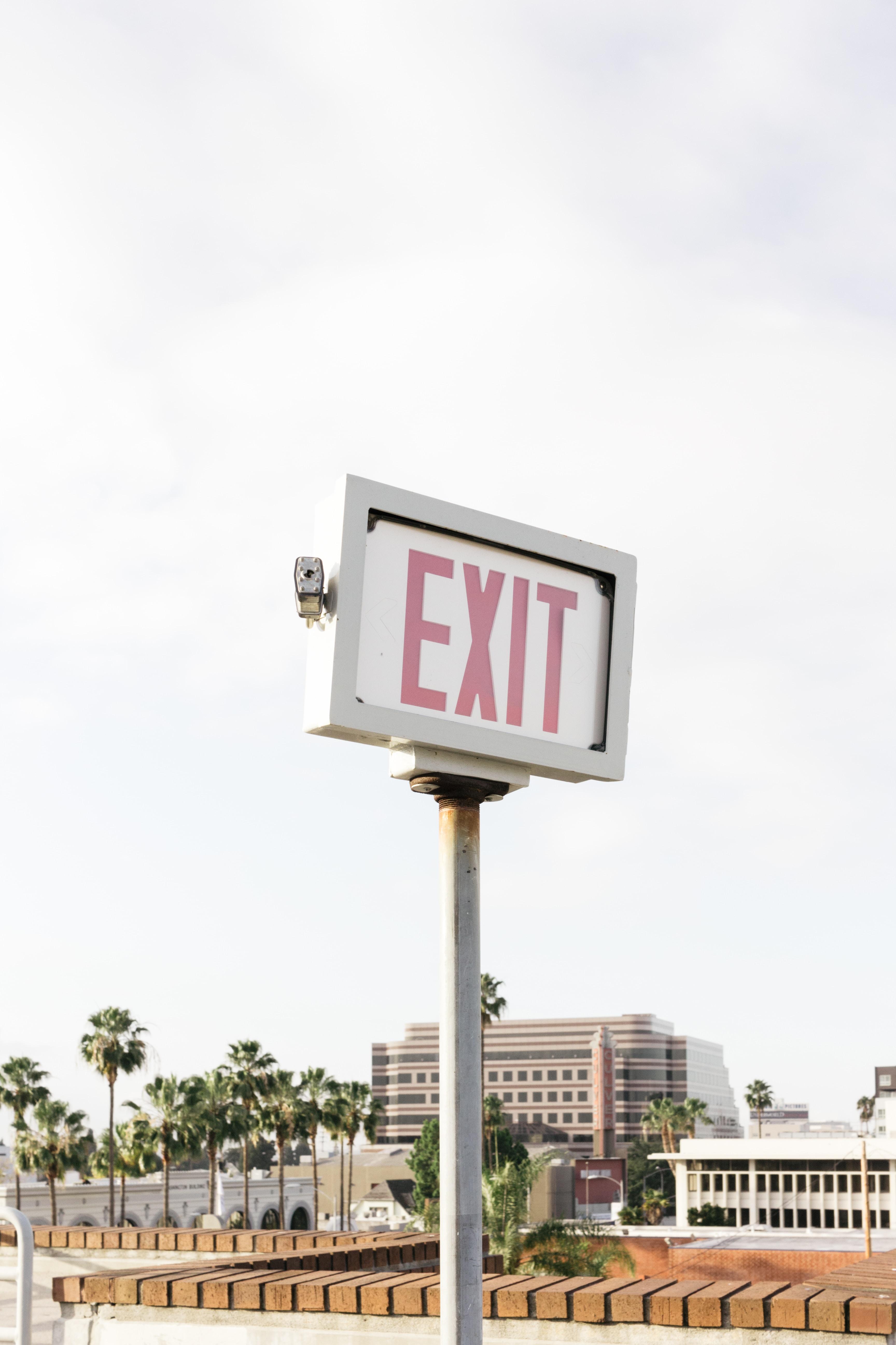 Exit signage near concrete building