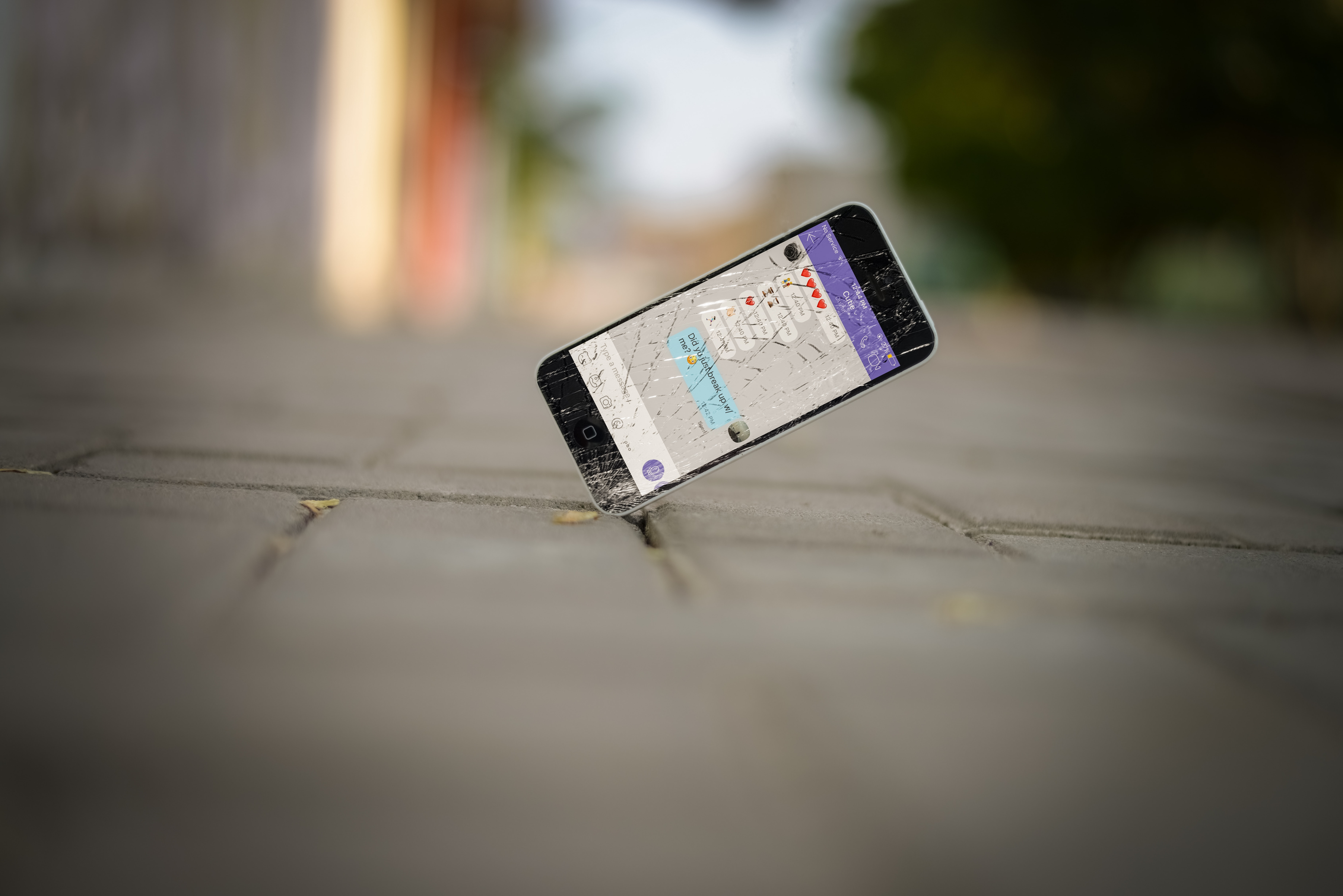 selective focus photo of iPhone balance on brick pavement