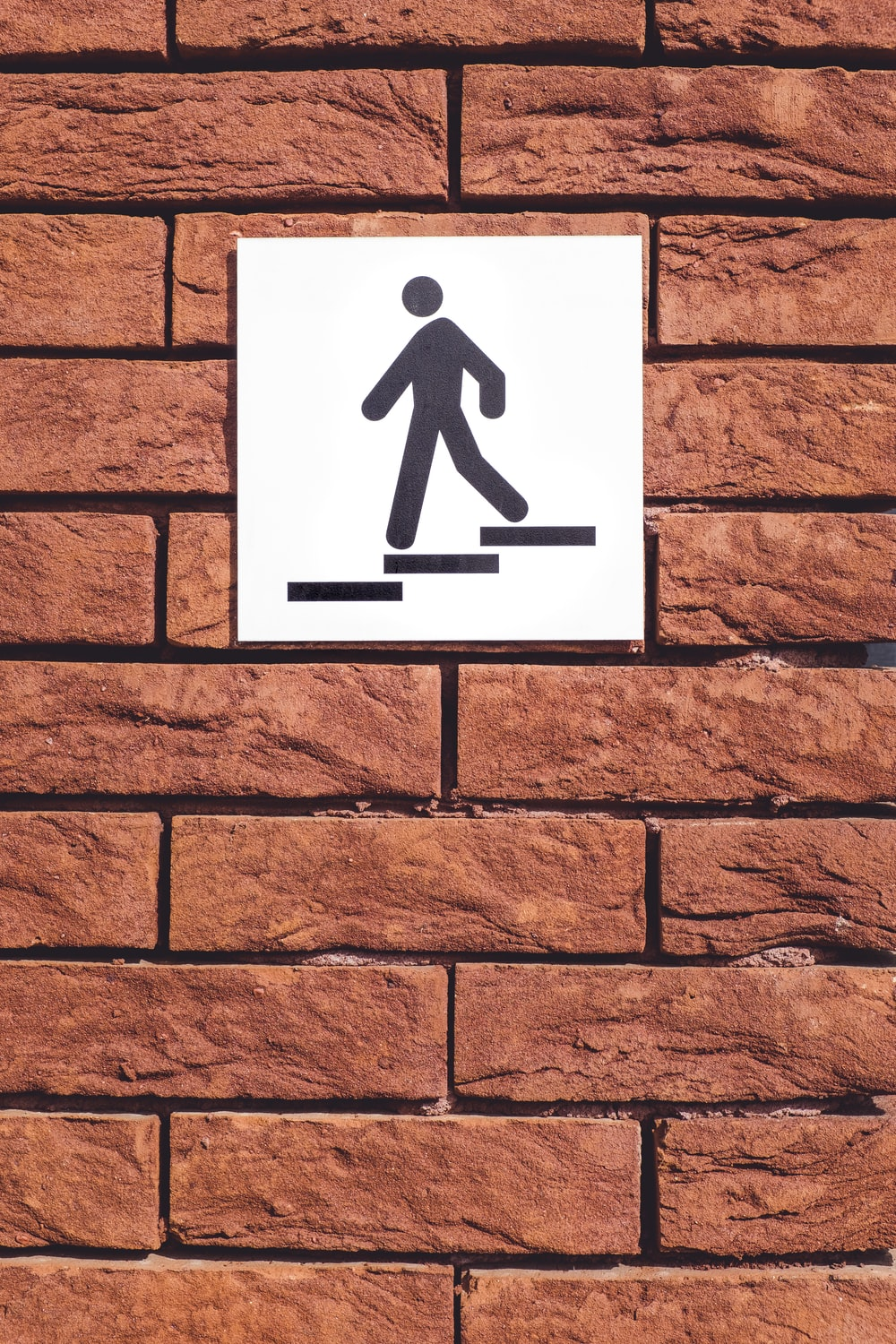 white and black signage mountain on wall
