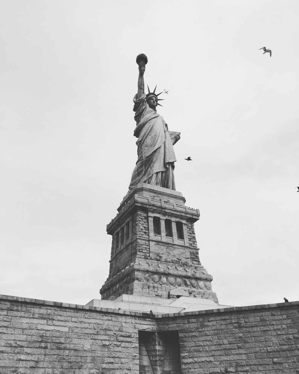 grayscale photography of Statue of Liberty