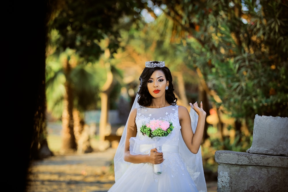 selective focus photograph of woman wearing white wedding dress