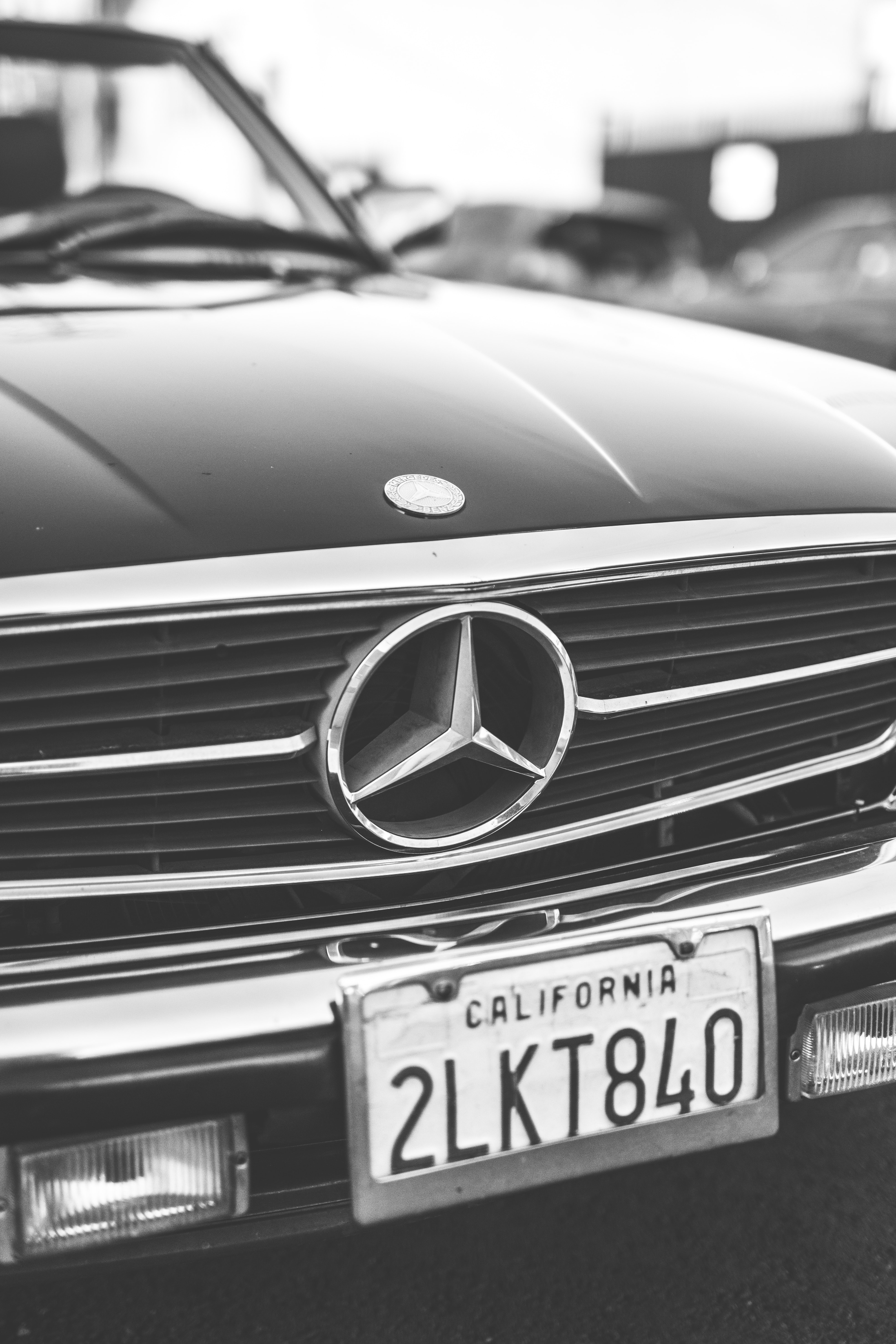 grayscale photo of Mercedes-Benz