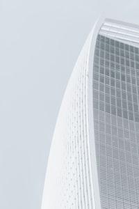 white concrete multi-storey skyscraper at daytime