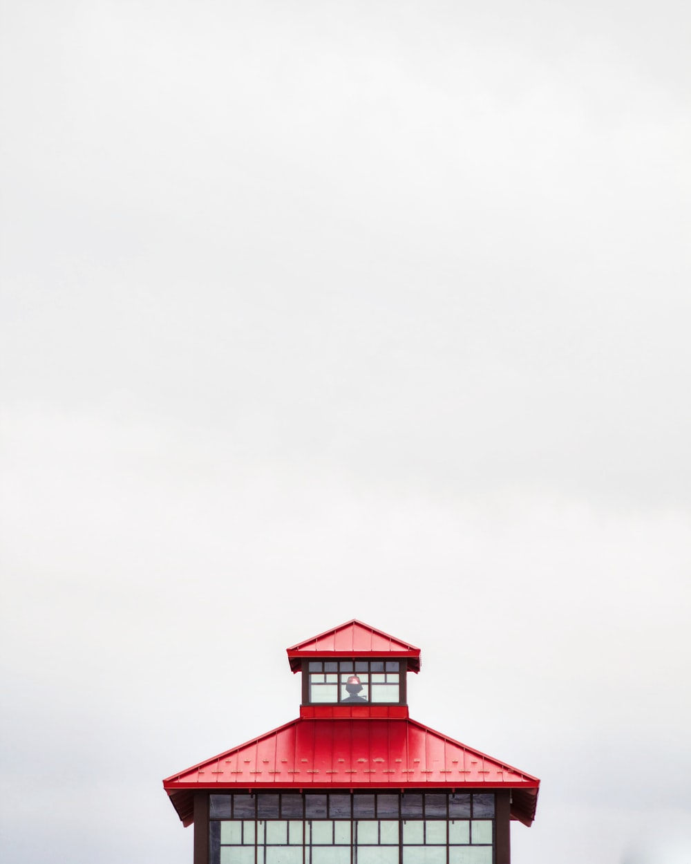 closeup photo of red and black pagoda on white background