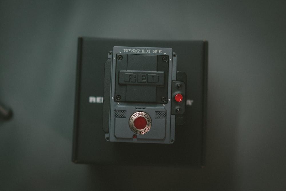 black and gray remote on black box
