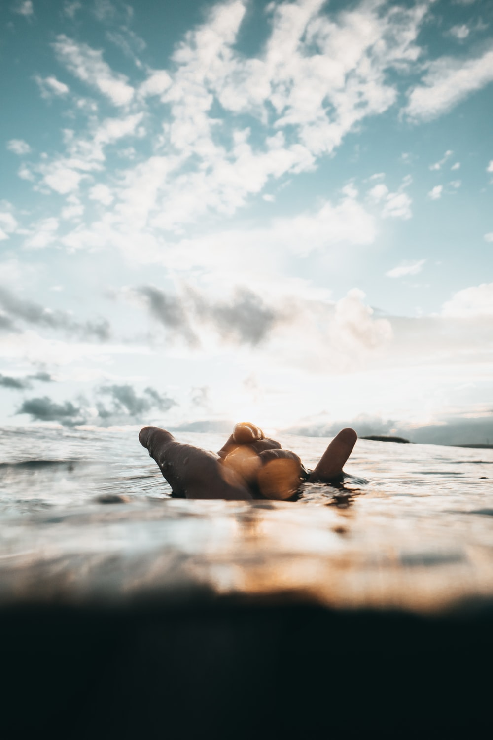 photo of person's submerging in body of water