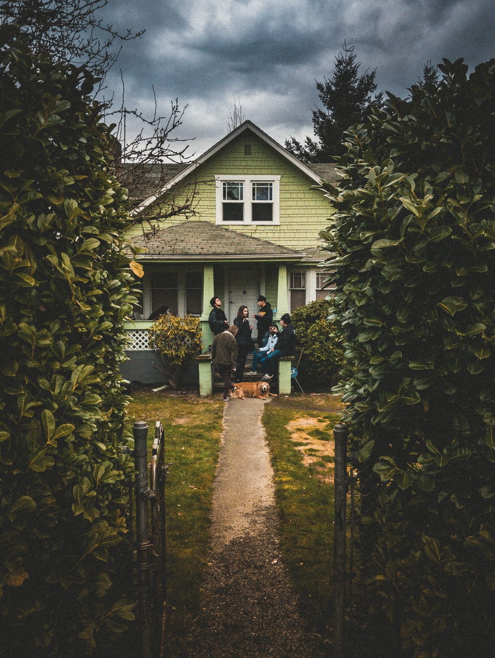 people standing near closed door house