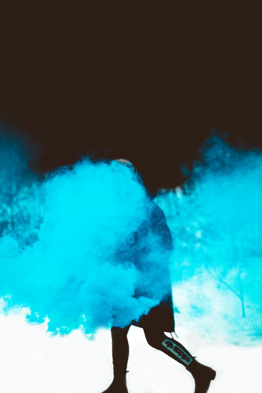 person walks with blue smok
