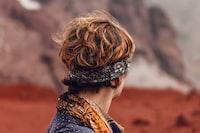 person wearing gray headband