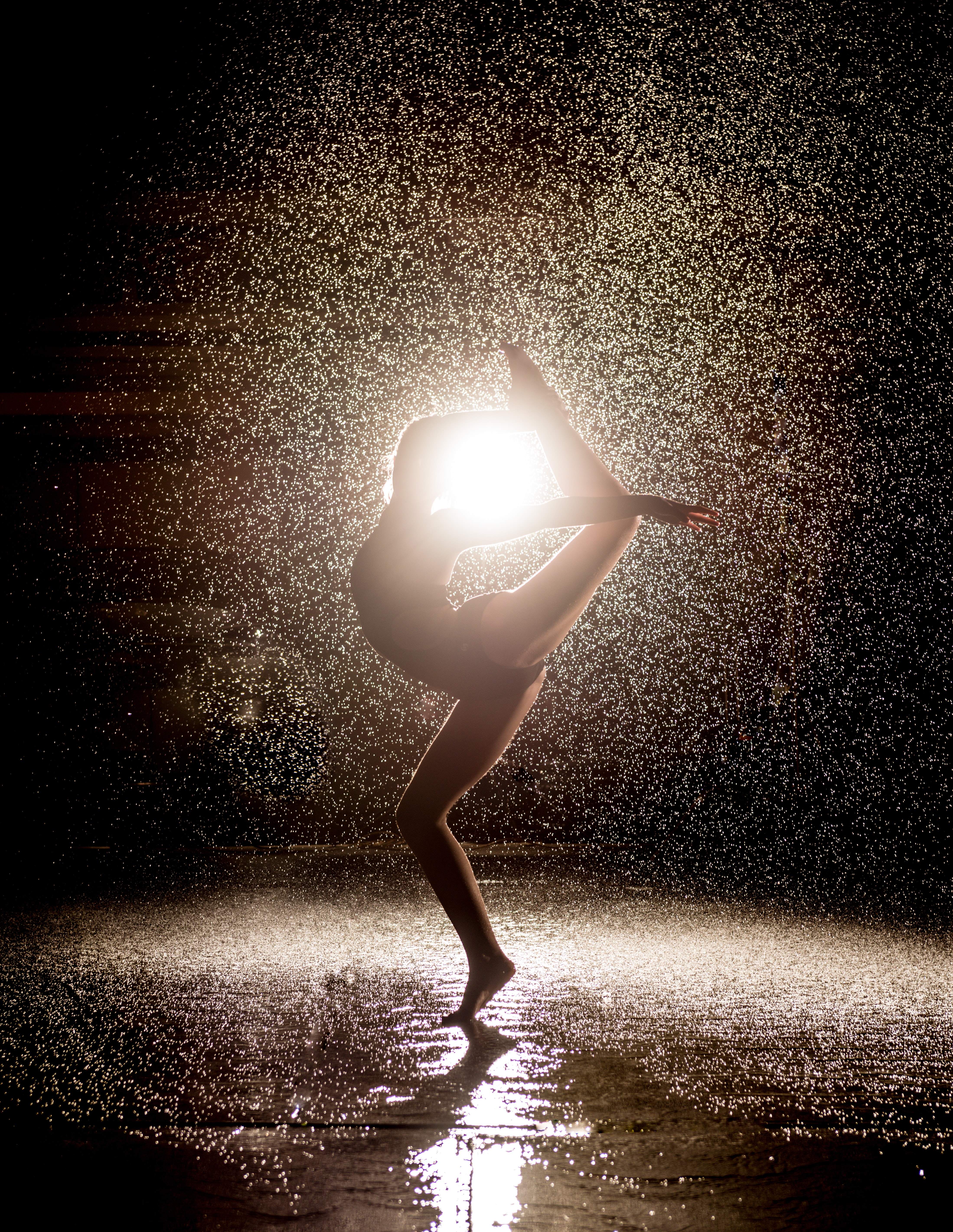 woman dancing in the rain