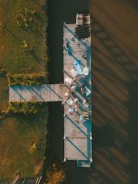 bird's eye photography of group of people gathered on dock