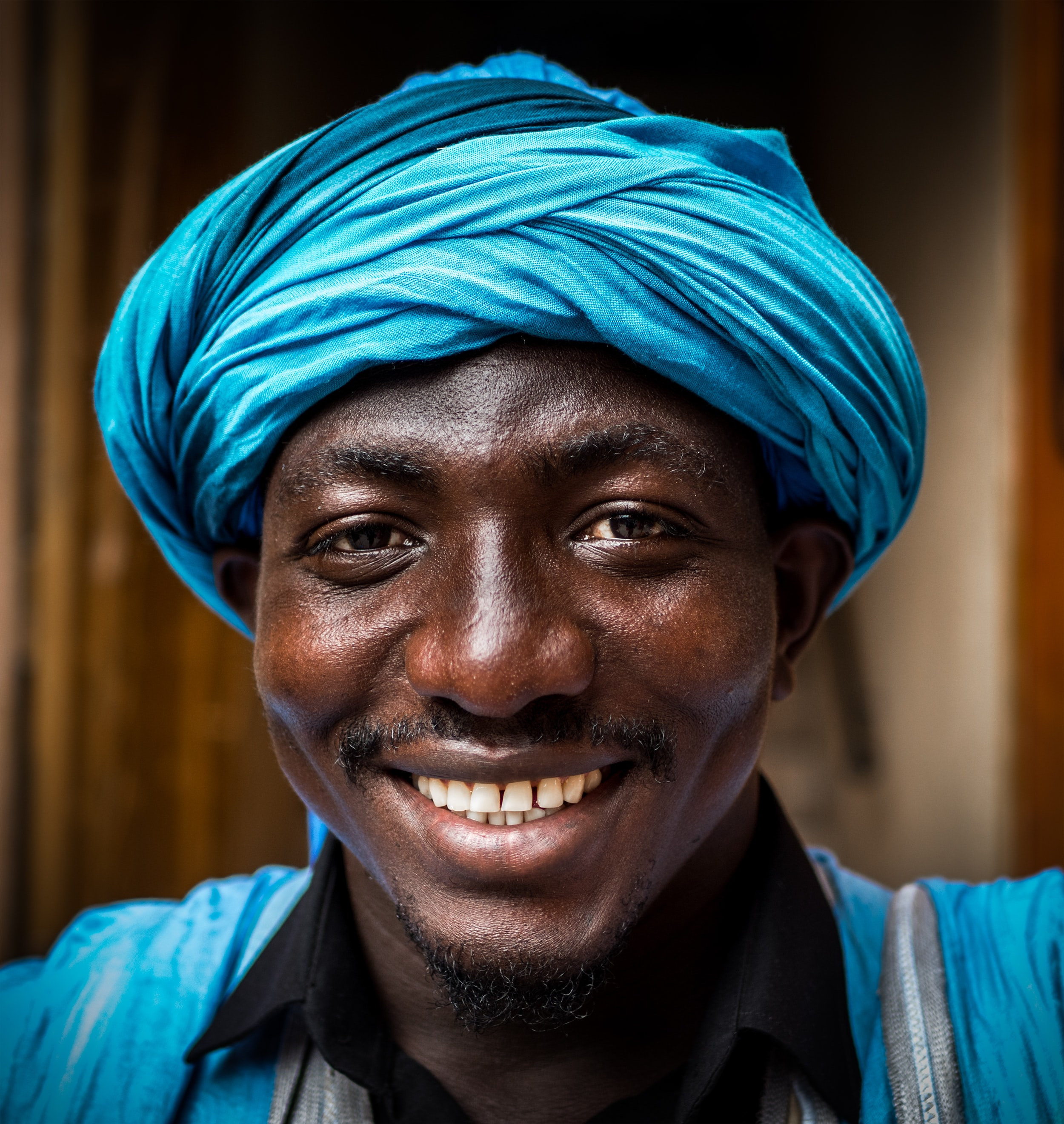 man wearing blue headdress
