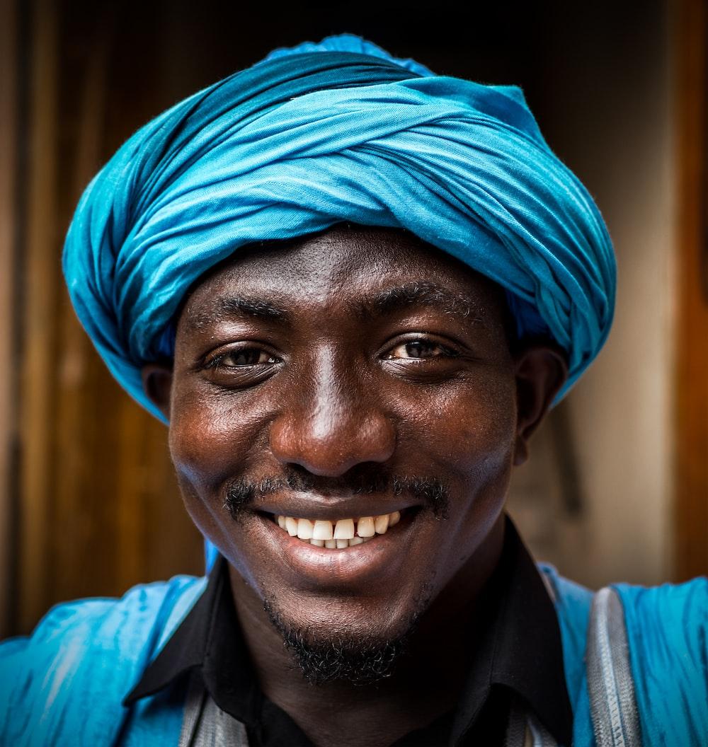 man wearing blue headdress