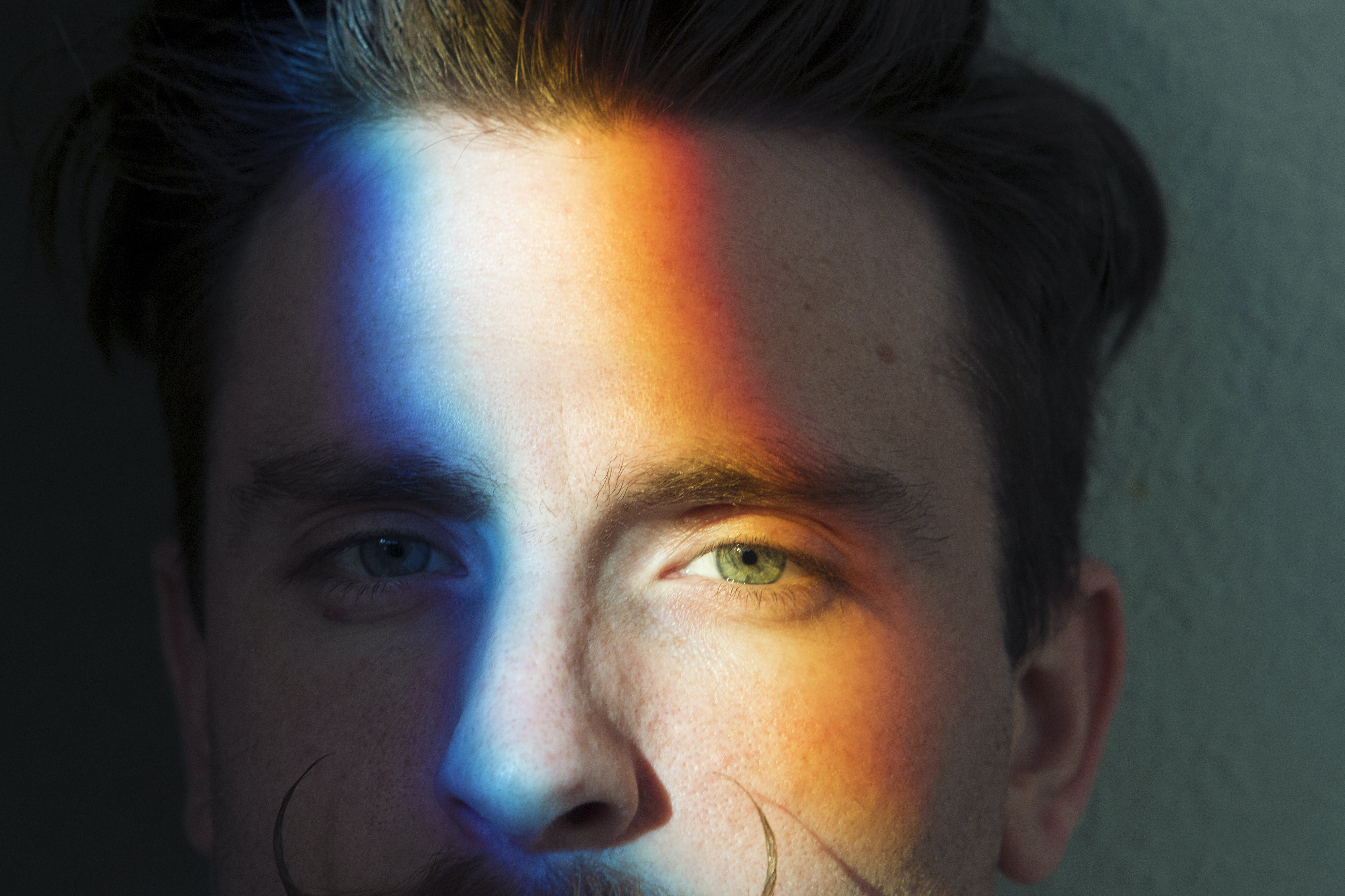 closeup photo of man's face with light reflections