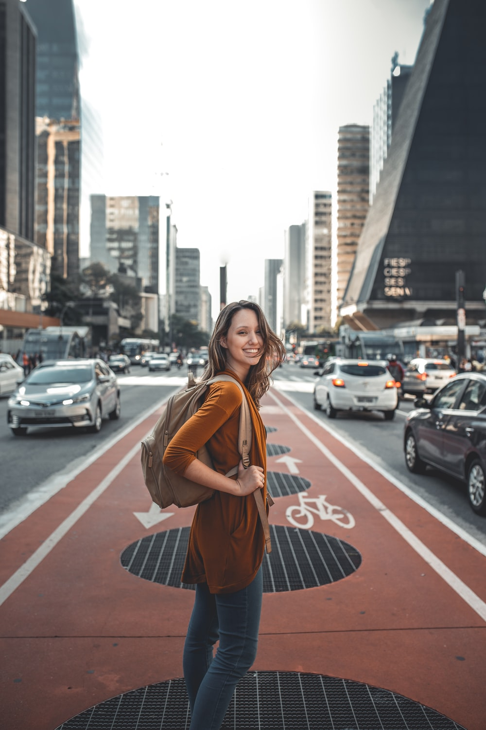 woman standing on middle of road