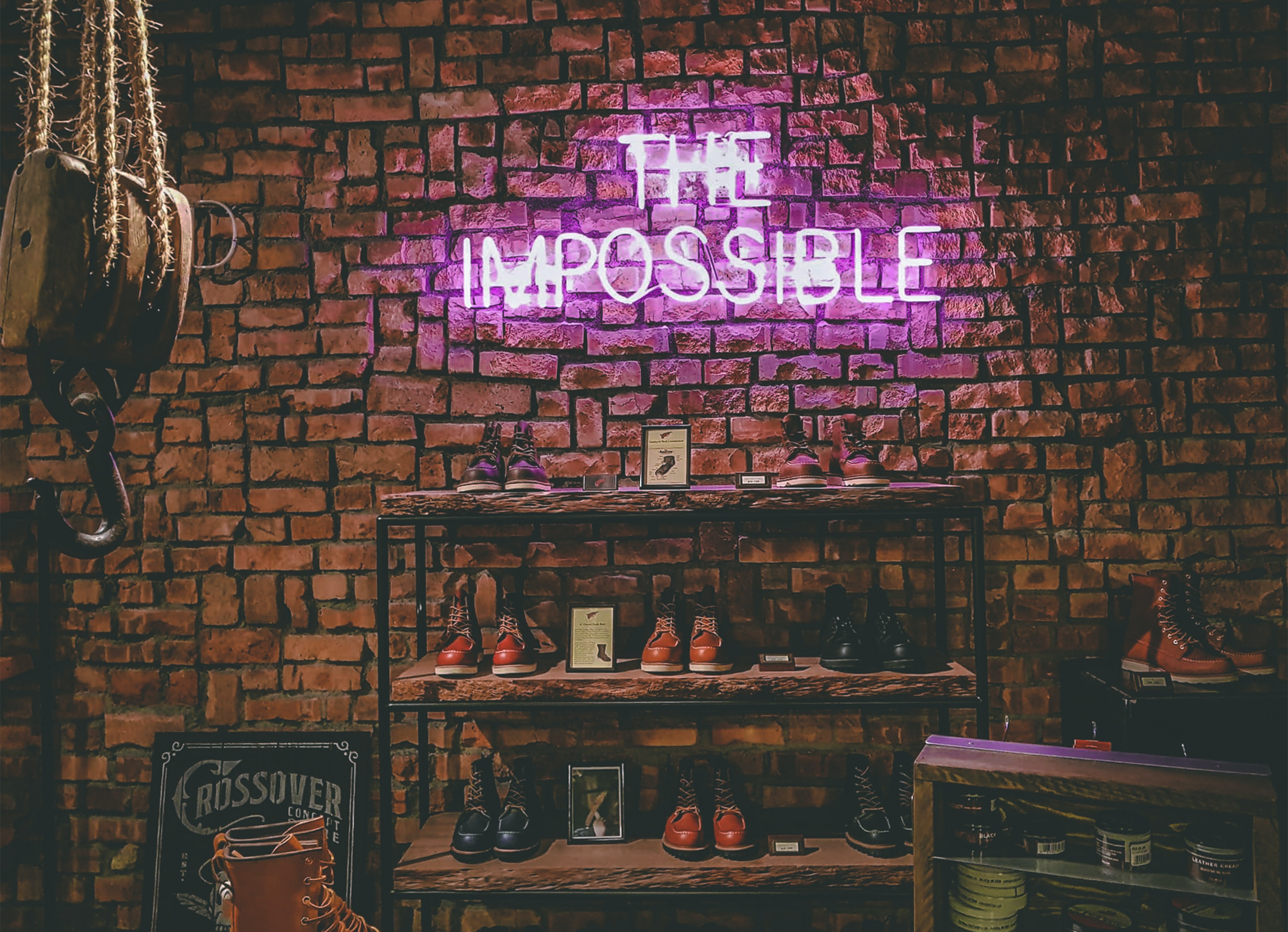 The Impossible neon light signage on brick wall