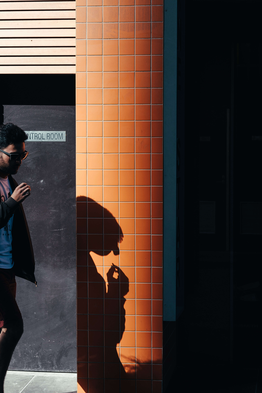 man walking beside the control room